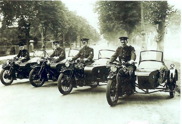 Four motorcycles and side-cars dated 1938. Left  to right: Police Constables  Arthur Finch;  Jack Greenall;  unknown; Dick Pole. (Gloucestershire Police Archives URN 1512)