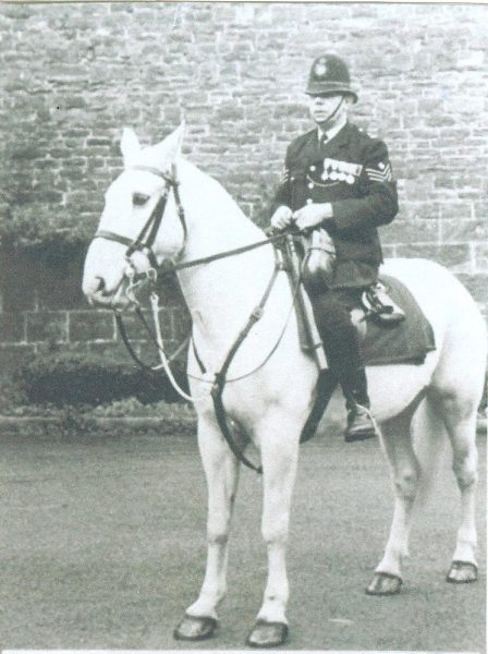 Police Sergeant Harry Watkins of Littledean, mounted on a horse at time of his retirement from Gloucestershire  Constabulary 1953. The horse was called Silver and belonged to Lionel Virgo of Court Farm Littledean. (Gloucestershire Police Archives URN 154a)