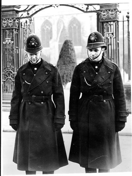 Police Constables Roy Adlem and Graham Gibbons outside Tewkesbury Abbey on the  occasion of  service commemorating funeral of King George V in 1953. (Gloucestershire Police Archives URN 742)