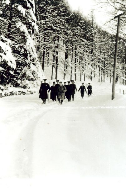 Officers marching through the snow  to get to Birdlip Police Station, Winter 1947. (Gloucestershire Police Archives URN 942)