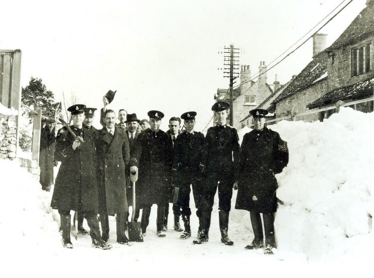 Police rescue Birdlip villagers 1947. Left to right: Police Constable Williams, Police Sergeant N Baker, Police Constable J Johnston, Inspector C. Walkley, Inspector A. Miller, Police Constable C.A.T. Nicholls, Cadet T. Jones, Cadet T. Holloway, Cadet R.A. (Bob) Parker, Police Sergeant J. E. Squire. (Gloucestershire Police Archives URN 947)
