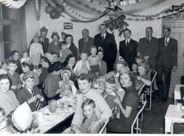 Childrens Christmas Party at Police Headquarters Clubroom 31st December 1955. Back row left to right: Doug Baker, Pat Tracy, unknown , unknown, Chief Constable Colonel Henn, Assistant Chief Constable Bert Carter, Len Starnes, John Howkins, Eric Jenkins, also shown Mrs Barbara Parker, Mrs Doreen Bridgman, Mrs Ken Clark, Mrs Doug Baker. (Gloucestershire Police Archives URN 1009)