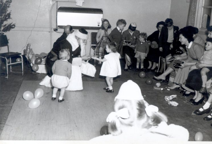 Children's Christmas Party at Police headquarters 1957. Mrs Anne Pittaway leaning forward.  Mrs Pat Pittaway on her left. (Gloucestershire Police Archives URN 1012)