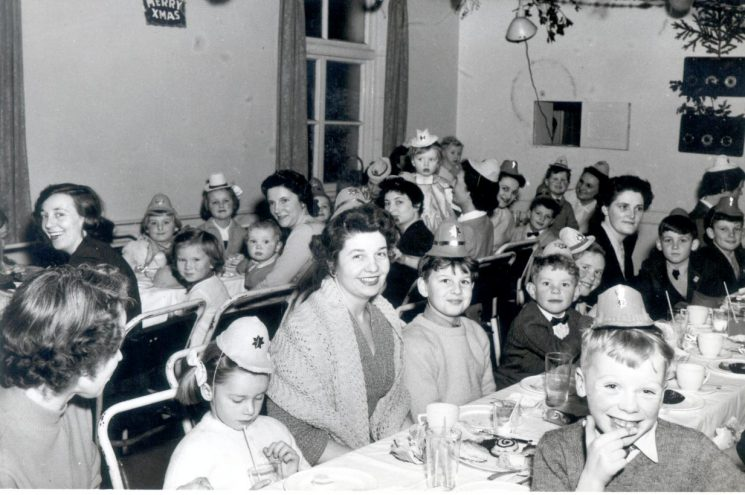 Christmas party at Headquarters  1956. Mrs Barbara Parker, with son Martin and daughter Anne,  Mrs Anne and Pat Pittaway also in photo. (Gloucestershire Police Archives URN 1013)