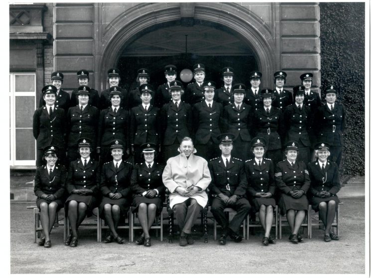 Number Seven District Course for Women Police Constables at Eastwood Park, Falfield 1968/69. Middle Row: second from left Women Police Constables Margaret Jones,  Sue Jenkins. Front row, second from left, Woman Inspector Mary Pincombe, sixth from left, Chief Inspector Bob Parker, seventh from left Woman Chief Inspector  E.(Betty) Hughes, eighth from left Woman Sergeant Dulcie Blowen. (Gloucestershire Police Archives URN 1016)