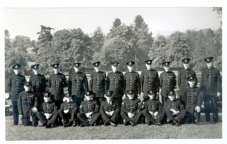 Parade of Gloucestershire Constabulary Motor Patrol Officers c. 1949. Left to right  unknown, Ben Gwilliam, Tom Pugsley, Bill Harris, Police Sergeant Norman Baker, Lionel Winfield, Tom ?, Ken Fairbanks, Jack Daykin, C.A.S. Smith, Paul Foice Front Row - Left  to right - Arthur Tucker, Charles Nicholls, Derek Beasant, Jack Squires, Jack Greenall, Len Cox, Bill Turner, Percy ?, Campbell Willett. (Gloucestershire Police Archives URN 1037)