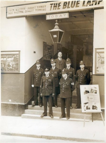 Police Officers outside the Dursley Victoria Cinema 1949 at showing of the film 'The Blue Lamp'. Back row left to right: Police Constables Gordon Smith, Ron Robinson, Jock Hart, Fred Charles. Front row  Inspector Auger and Police Sergeant Hopkins. (Gloucestershire Police Archives URN 1042)