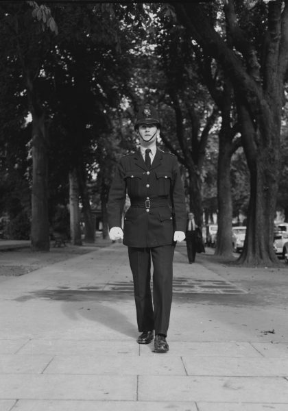 Police Constable wearing the new issue of uniform (change to collar and tie from high collar) 1954. (Gloucestershire Police Archives URN 1089)