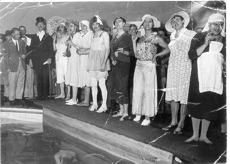 Police Swimming Gala 1930. Third from right Police Constable Ernest W. Slade Cheltenham wearing silk pyjamas and bridesmaids hat. (Gloucestershire Police Archives URN 1116)