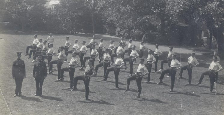 Male Recruits undergoing physical training at Police Headquarters New Court June 1919. (Gloucestershire Police Archives URN 113)
