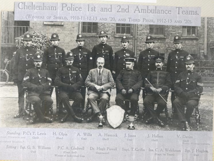 Cheltenham Police first  & second ambulance teams - winners of shield 1910 -1911 -1913 -1920 and third prize 1912 -1913 -1920. Superintendent R.T. Griffin; Inspector C.H. Welchman; Police Sergeants J. Hughes and G.S. Williams; Police Constables T. Lewis; H. Olpin; A. Willis; A. Hancock; J. Jones; J. Hallam; V. Davies; A. Gladwell; and Dr. Hugh Powell. (Gloucestershire Police Archives URN 117)