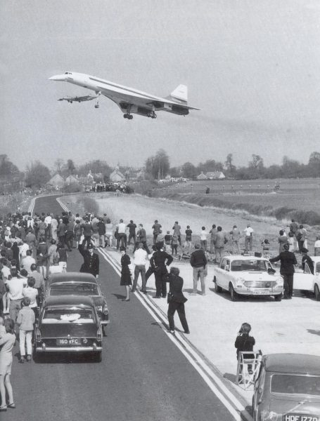 Officers left to right; Philip Hopson, Pam Allen ( Wakefield), Dave Smeeton ( back to camera ) and Bob Lightfoot, with Sgt. Dave Thomas exiting the car at far right, on duty on the Whelford to Kempsford Road for Concorde's first landing at Royal Air Force Fairford 9th April 1969. The British prototype of Concorde flew from its test base at Filton (also in Gloucestershire)  the pilot was Brian Trubshaw.  A  Canberra chase plane and Gloucestershire Constabulary Austin 1800S patrol car are also in the picture. (Gloucestershire Police Archives URN 1208)