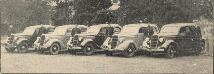Gloucestershire Constabulary taking delivery of 5 Ford V8 patrol cars 1935. Officers shown left to right:- Police Constables Arthur Finch, CAS Smith, Leonard Lovell, Norman Baker, Frank Lewton, Superintendent A Sainsbury and Mr Tait from Victory Motor Co, Cheltenham. (Gloucestershire Police Archives URN 1216)