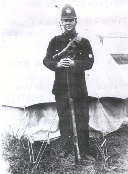 Police Constable 201 Joseph McKnight with rifle by a tent.Thought to be guard on Severn Railway Bridge during the 1914-18 war. (Gloucestershire Police Archives URN 1225)