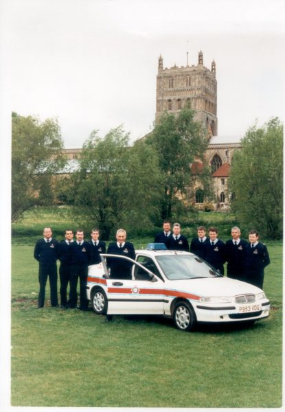 Tewkesbury Police Incident Response Vehicle  and crews. Left to right:  Jim Wlkinson, Police Sergeant Clive Gillingham, Paul Johns, Dave Knox, Inspector Geoff Sindrey, Roy Owen, Pete Bennett, Gareth Hughes, Wayne Oliffe, Kevin (Buck) Rogers. (Gloucestershire Police Archives URN 1232)