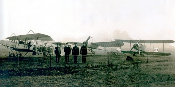 Unidentified officers with  three early aircraft,belonging to the Army Aviation corps. Cheltenham October 1913. (Gloucestershire Police Archives URN 1244)
