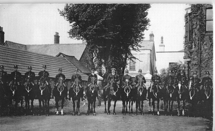 Gloucestershire Constabulary mounted police at Miners' Strike - Forest of Dean in 1926. Photograph taken at Feathers Hotel Lydney. Police Constable Harry Watkins on the right. Police Constable  John Meadows seventh  from the right Police Constable Morton Fluck second from right (Gloucestershire Police Archives URN 127)