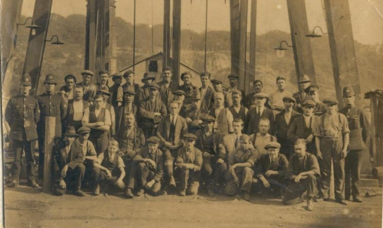 Miners and four uniformed police constables taken at Princess Royal Colliery pithead, Forest of Dean - 1926. Second from left is Police Constable 43 Fitzroy F. Taylor stationed at Lydney. (Gloucestershire Police Archives URN 130)