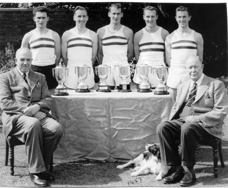Gloucestershire Constabulary Sports Relay team 1957. Standing left to right: A. Smith; B. Marshall; P. Keene; C. Jefferies; C. Viles. Seated: Assistant Chief Constable A. H. Carter ; Chief Constable Colonel. W. F. Henn. (Gloucestershire Police Archives URN 1321)