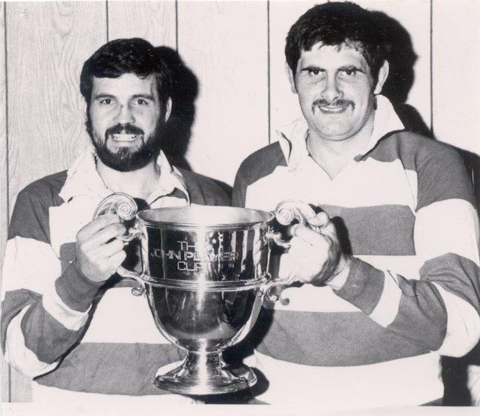 Officers holding the John Player cup for rugby, both playing for Gloucester. Police Constables Richard Jardine and John Fidler. (Gloucestershire Police Archives URN 1323)
