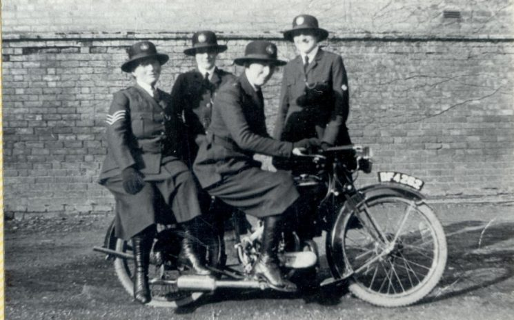 Woman Police Constable Rouse on Raleigh 'Saddletank' motor cycle No. DF 4282  with   Woman Police Sergeant Gale and Woman Police Constables Gray and Fay Southern Division 1928. (Gloucestershire Police Archives URN 139)