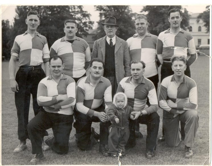 Gloucester Tug-O-war team with baby. The baby is Ann Blake. Back row left to right: Peter Blake; S. Messam Police Sergeant Gowell; C. Birch J. Morrison; Front row left to right: unknown; D. O'Connor; unknown; A. Wadley. (Gloucestershire Police Archives URN 1398)