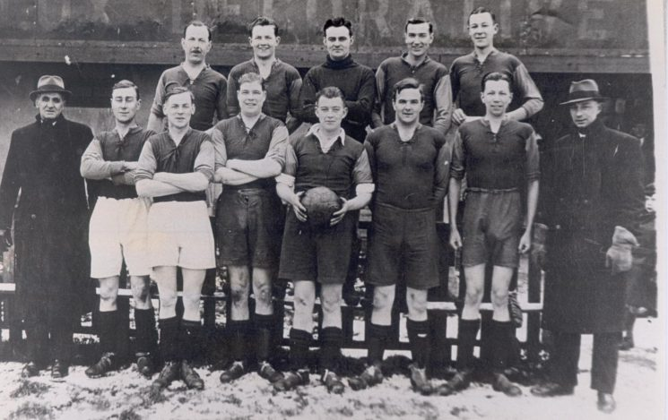 Gloucester Police versus Gloucester City Football Team in aid of Lord Lieutenant's fund at Gloucester  City Ground Horton Road. Back row: B. Bascombe, D. Parsons, G. Saunders, J .Drennan, M. Mills, Front Row: W Tilling, S. Hiron, B. Gwilliam, R .Parker, H. Pennington, V Batstone, R Miller, W James 1940. (Gloucestershire Police Archives URN 144)