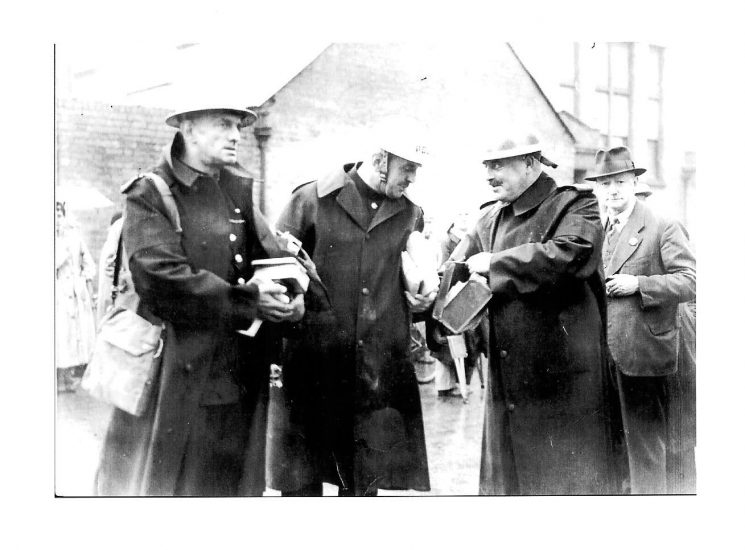 Police officers recovering property from a bomb-site in Stoneville St Cheltenham 1941. Attache case held by Police Sergeant John Parsons was found under a bed and contained £1,000.  Left of picture Police Sergeant Tremlin, with Inspector Ted Brant centre. (Gloucestershire Police Archives URN 1441)