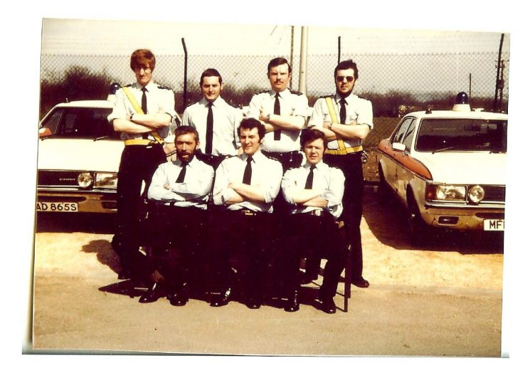 Traffic shift at Bamfurlong Motor patrol centre 1980s. Front row left to right : Police Constable Tony (Butty) Hughes;  Police Sergeant Gerry Lewis; Police Constable Clive Heaven. Back Row left to right: Police Constables   Paul Crabtree;  Pete Rowlands; Nigel Murray;  C. Jones. (Gloucestershire Police Archives URN 1451)