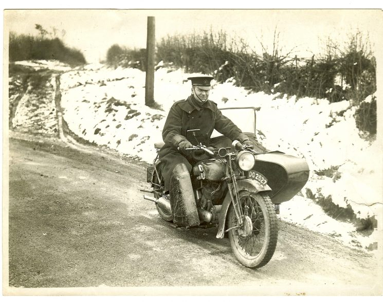 Police Constable 126 Tom Pittaway on motorcycle and side-car, reg no DG 2627, believed to be at Birdlip, in the snow 1938. (Gloucestershire Police Archives URN 1466)