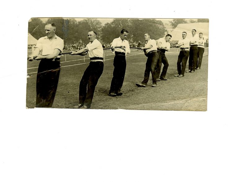 Police tug of war team 1930, Police Constable 126 Tom Pittaway fourth from the left. (Gloucestershire Police Archives URN 1467)