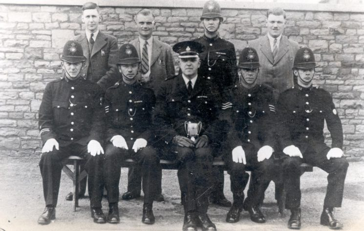 No 11 Area Civil Defence Darts League winners 1942-1943. Nine unnamed officers senior officer believed to be Superintendent A.H. Carter. (Gloucestershire Police Archives URN 147)