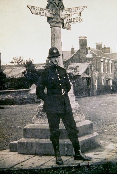 Police officer (385?) in uniform at the cross in Eastington. (Gloucestershire Police Archives URN 1555)
