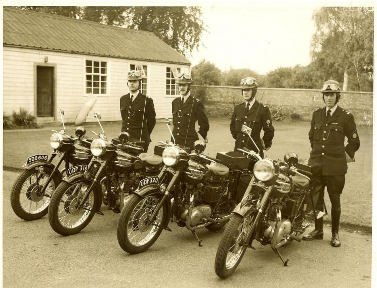 First main road motorcycle (Triumphs) section employed solely in summer & good weather at  Police Headquarters. Left to right: Police Constables Pat Pittaway, SDG 606;  Des Webb, UDF 318;  Bernard Sprason, UDF 320;  Alan Howarth, UDF 319. (Gloucestershire Police Archives URN 1566)