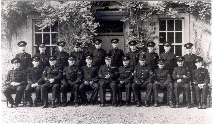 Kings Stanley/ Leonard Stanley/ Frocester Special Constabulary. Back row: Special Constables Perry, Eaton, Jenner, Priestley, Wathen, Lawrence, Casson, Patrick, Howell, Chudleigh, Front row : Special Constables Howard, Weakford, Pullin, Special Sergeant Cutis-Heyward, Special Superintendent Limbrick, Superintendent Williams, Special Inspector Bendall, Police Sergeant Webber, Special Constables Price, King, Smith. (Gloucestershire Police Archives URN 160)