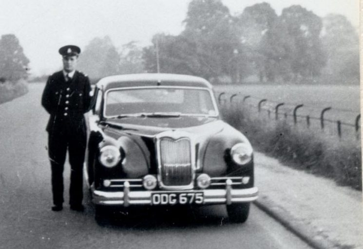 Police Constable 538 Roy Adlem on the Stonehouse to Eastington Road near Claypits with Riley Pathfinder car ODG 675 in 1956/7.  (new in 1955). (Gloucestershire Police Archives URN 162)
