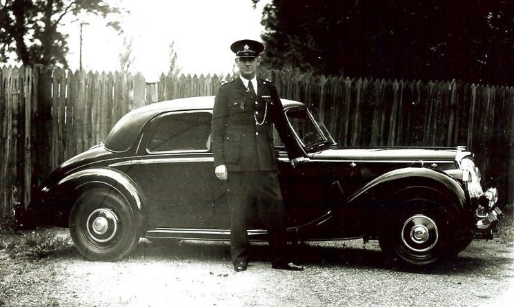 Inspector Jack Greenall with Riley patrol car. (Gloucestershire Police Archives URN 163)