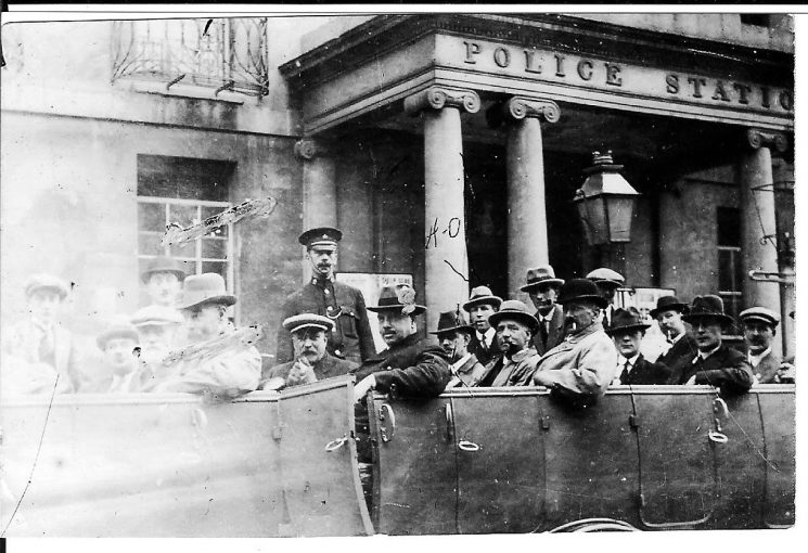 Off-duty officers on a social outing departing from Cheltenham Police station, Harry Olpin identified (HO) - others not known. (Gloucestershire Police Archives URN 1700)