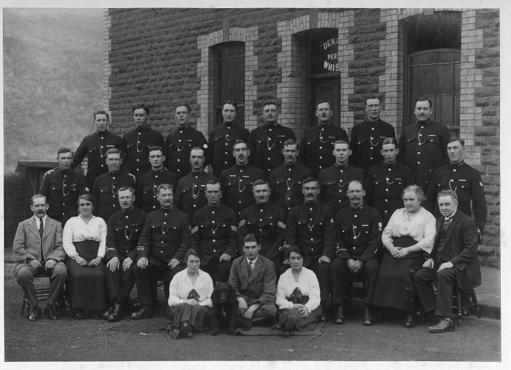 Group photo taken at an unknown location.  Appears to be the station complement.  Retired Police Sergeant Harry Olpin believed to be fifth from left in front row. (Gloucestershire Police Archives URN 1701)
