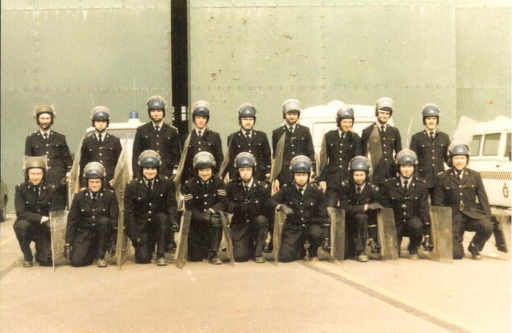 Riot Shield Training at Royal Logistic Corps Barracks, Aston Down. Back left - Keith Bucknall.     Back right - Nigel Lawrence Front, second right - Steven Parker. (Gloucestershire Police Archives URN 1763)