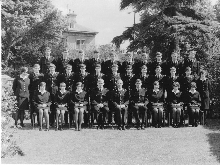 Regular Police Cadets at Headquarters 1972. Back Row left to right: Rob Coltman, Jon Parnell, Robin Yates, Richard Stallabrass, Steve Robertson, Paul Adams, Martyn Speke, John Minter, Richard Bradley and  Simon Bailey. Middle: Anne Brothers, Steve Parker, Kelvin Voss, Trevor Jones, Graham Rees, Gerry Blythe, John Punter, Colin Heselton, Paul Tibbles, Rob Lephard, Ian Perry, Bill Watson and  Sarah Tavender. Sitting: Rose Petheram, Glynis Jacka, Carole Blyth, Police Constable Dave Hanks, Chief Inspector Ken Roberts, Police Sergeant David Price, Woman Police Constable Di Gibbs, Judy Berry and  Lesley Stoneman. (Gloucestershire Police Archives URN 1771-2)
