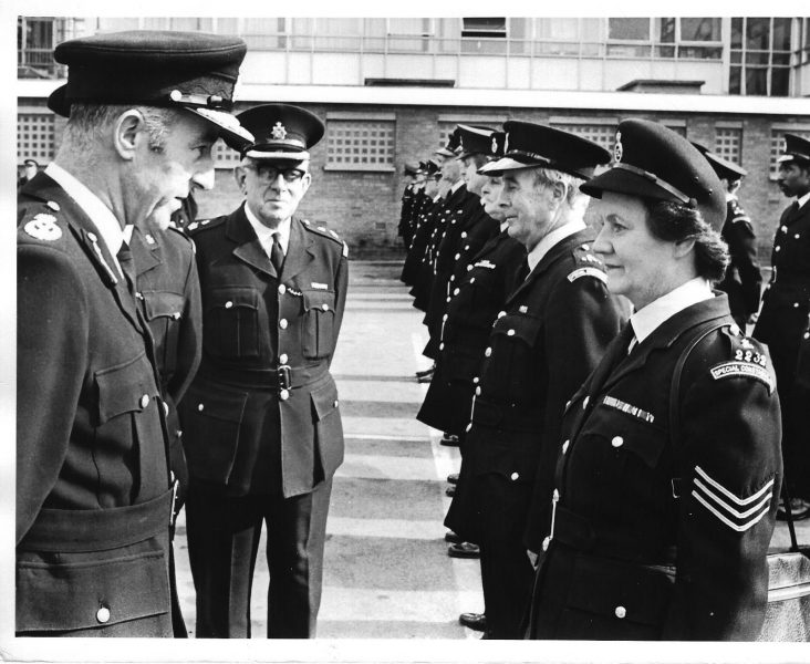 Special Constables parade at Gloucester. Inspecting officer chief Constable Brian Weigh talking to Special Police Sergeant Iris  Wrigglesworth  early 1970's her husband Gordon Wrigglesworth  was a special Chief Inspector. (Gloucestershire Police Archives URN 1840-2)