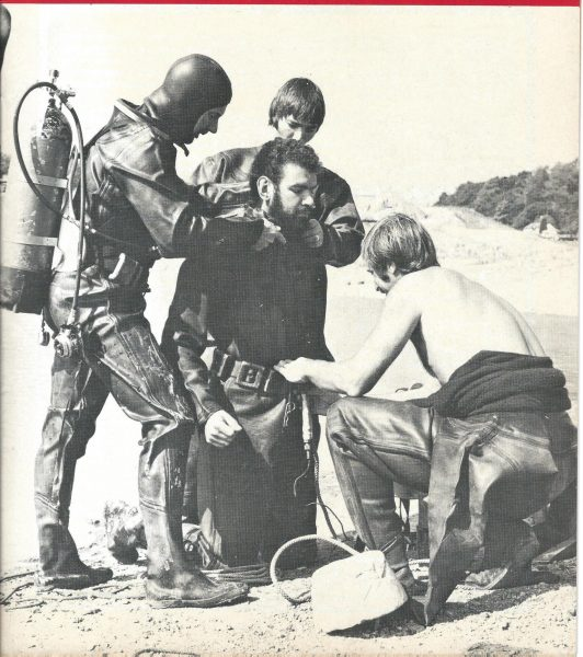 Gloucestershire Underwater Search team shown on the front cover of the Police Review magazine, 12th November 1976 Issue 4374. Left to right Police Sergeant Roger Renault; Police Constable Phil Uzzell, Police Constable  Jerry Herniman centre, Police Constable  Roger Sandell. (Gloucestershire Police Archives URN 1932)