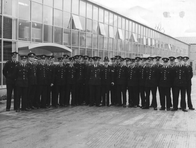 Regular Police Cadets visiting Dowty Rotol, Churchdown, 1961. Left to right: David Bryant; Roger Robinson; Anthony Blyth; Chris Phillips; Roger Sandall; Adrian Davies; Chris Raymer; Arthur Beacham; Adrian Wallace; David Baker; David Thompson; Brian Fletcher; Terry King; Robin Haines; Chief Inspector Baker; Police Sergeant Clark; Ray Trigg; Price; Peter Smith; David Godwin; Robin Berryman; Colin (?) Davis; Richard Hall; Whitcombe; Nigel Gale; Brian Bailey; Anthony Wilcox; Maidstone (?); Boyd. (Gloucestershire Police Archives URN 1966)