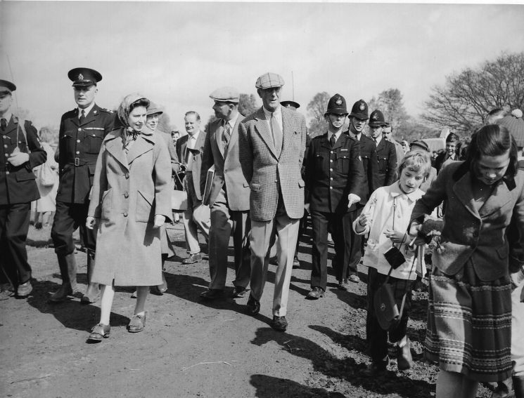 Her Majesty Queen Elizabeth at the Badminton Horse Trials 1961. Left to Right: Cadet David Thompson with radio pack-set; Inspector Lodge; second police constable  Ken Hudman (?); third police constable  Robin (Rumpus) Davis. (Gloucestershire Police Archives URN 1968)
