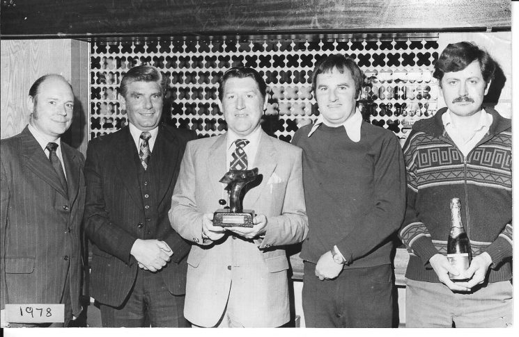 The winning team in the Charity Conker Match held in the Cirencester Police Club  with trophy October 1978. From left to right: Criminal Investigation Department  members Detective Constable David Lilley; Detective Sergeant  Chris Bartlett; Detective Constable Chris Daniels;Detective Constable Robert Price; Police Constable Paul Miller. (Gloucestershire Police Archives URN 1970)