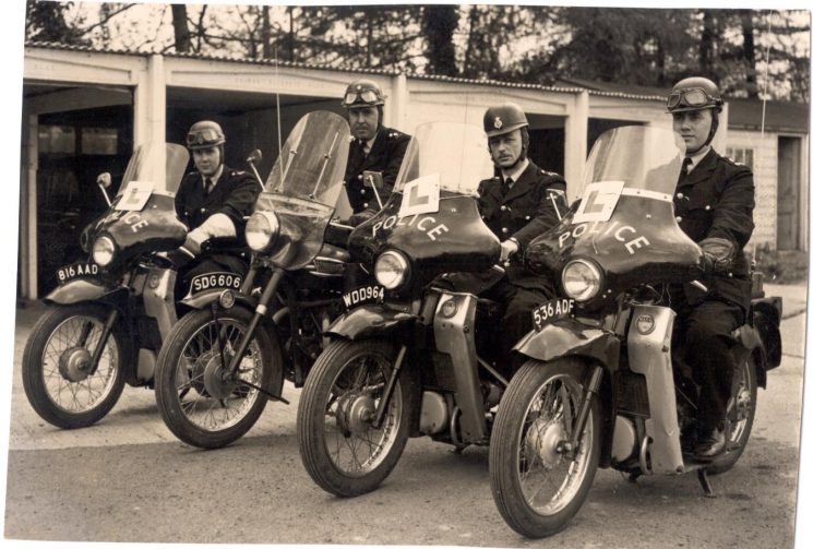 Police Constable J. Proctor on Triumph motor cycle SDG-606, three Police Constables on Velocette  Motor cycles. Training Course Constables believed to be left to right: Unknown, (816 AAD), Norman Green (WDD 964), Ken Price (536 ADF). (Gloucestershire Police Archives URN 199)