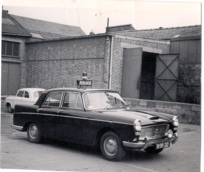 Austin A110 9199-DD outside Longsmith St Garage, 1964. (Gloucestershire Police Archives URN 207)