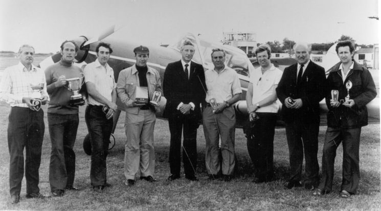 Competitors and aircraft at Staverton at Police Air Rally 1975, Deputy Chief Constable Coppin, with unnamed competitors. (Gloucestershire Police Archives URN 212)