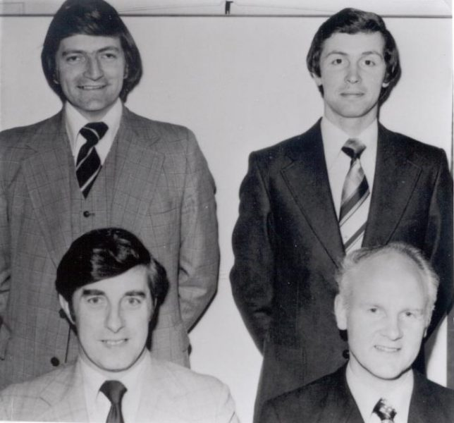 First fraud squad 1975. Standing Left to right Detective Constable Peter Burcombe Detective Constable Gordon James. Seated left to right: Detective Inspector Don Wyman, Detective Sergeant John Richings (Gloucestershire Police Archives URN 215)